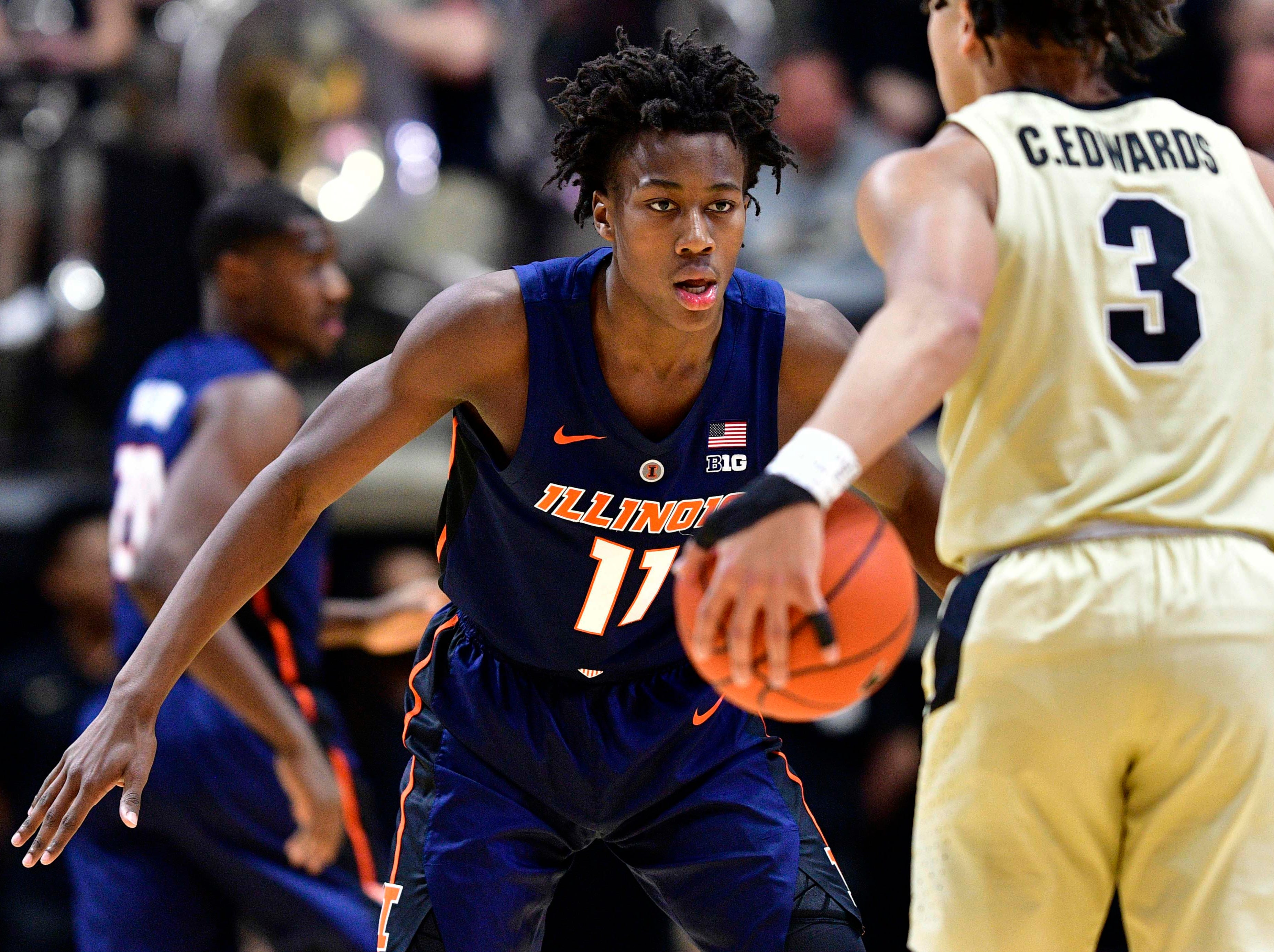 Feb 27, 2019; West Lafayette, IN, USA; Illinois Fighting Illini guard Ayo Dosunmu (11) looks to guard Purdue Boilermakers guard Carsen Edwards (3) during the first half of the game at Mackey Arena. Mandatory Credit: Marc Lebryk-USA TODAY Sports