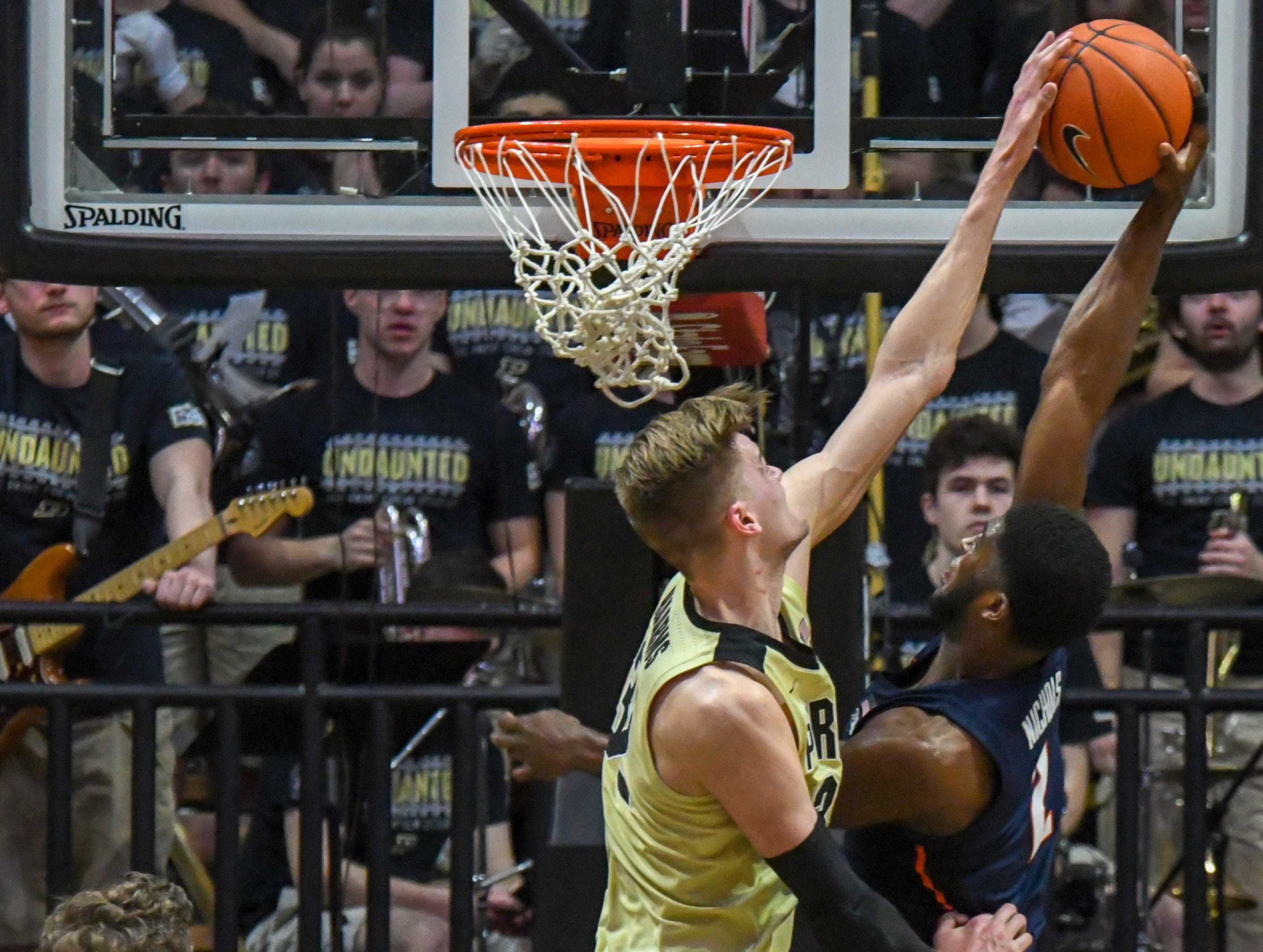 By Frank Oliver for the Journal and Courier --Purdue's Matt Haarms blocks Illinois' Kipper Nichols shot in Purdue's 73-56 win over Illinois on February 27, 2019 in West Lafayette.