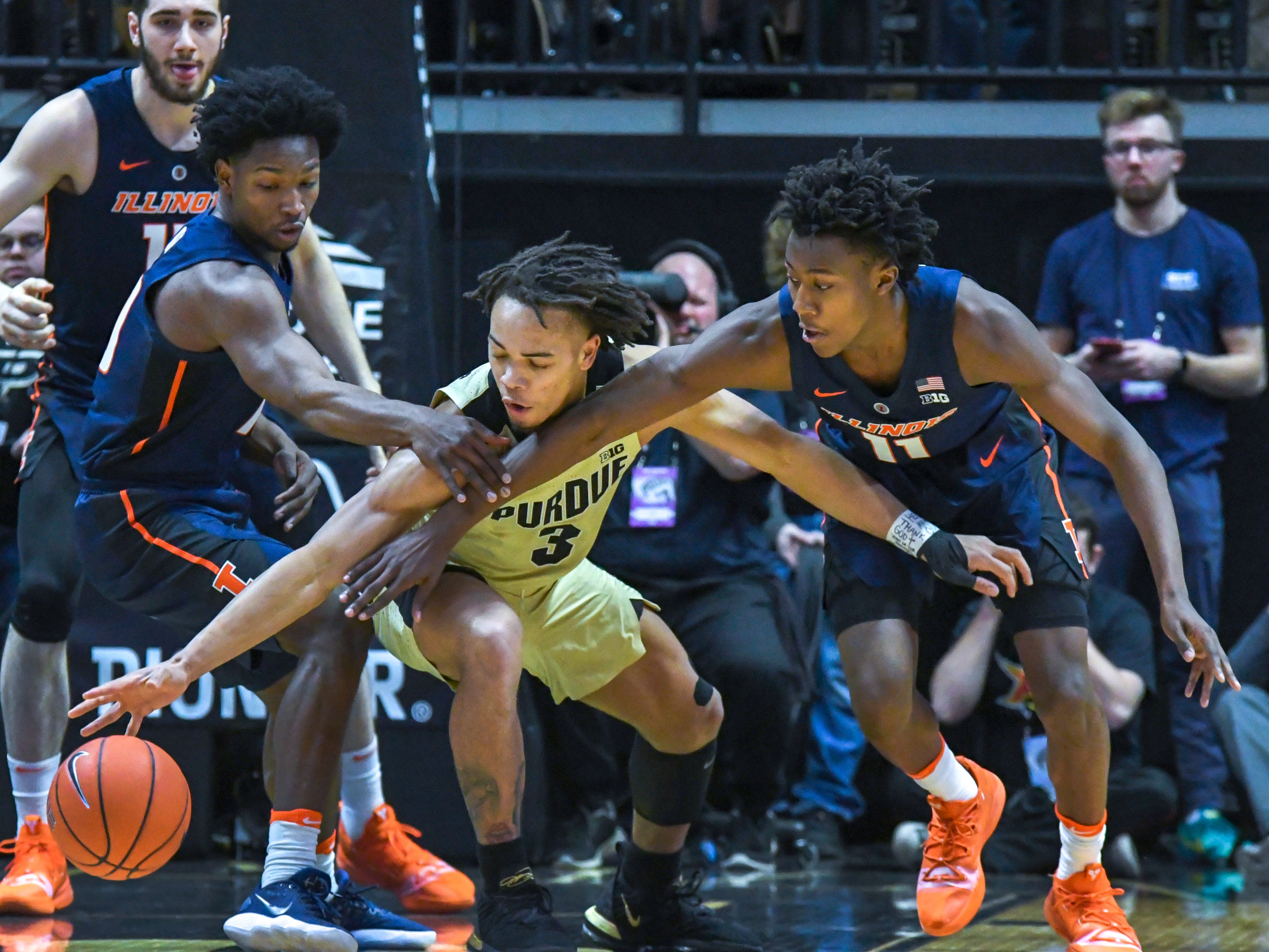 By Frank Oliver for the Journal and Courier --Purdue's Carsen Edwards, middle, battles Illinois players for control in the first half against Illinois on February 27, 2019 in West Lafayette.