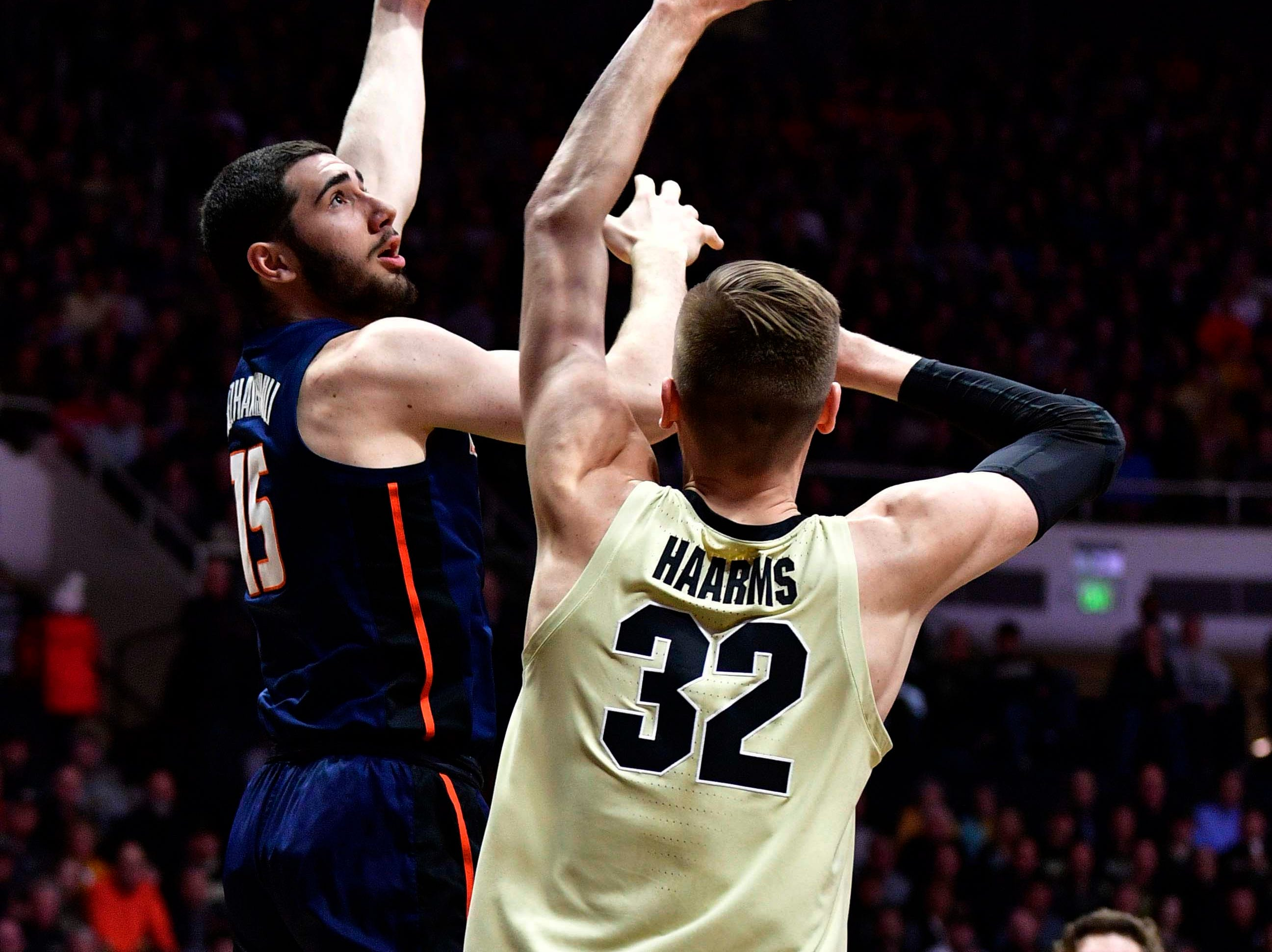 Feb 27, 2019; West Lafayette, IN, USA; Illinois Fighting Illini forward Giorgi Bezhanishvili (15) puts up a shot over Purdue Boilermakers center Matt Haarms (32) during the first half of the game at Mackey Arena. Mandatory Credit: Marc Lebryk-USA TODAY Sports