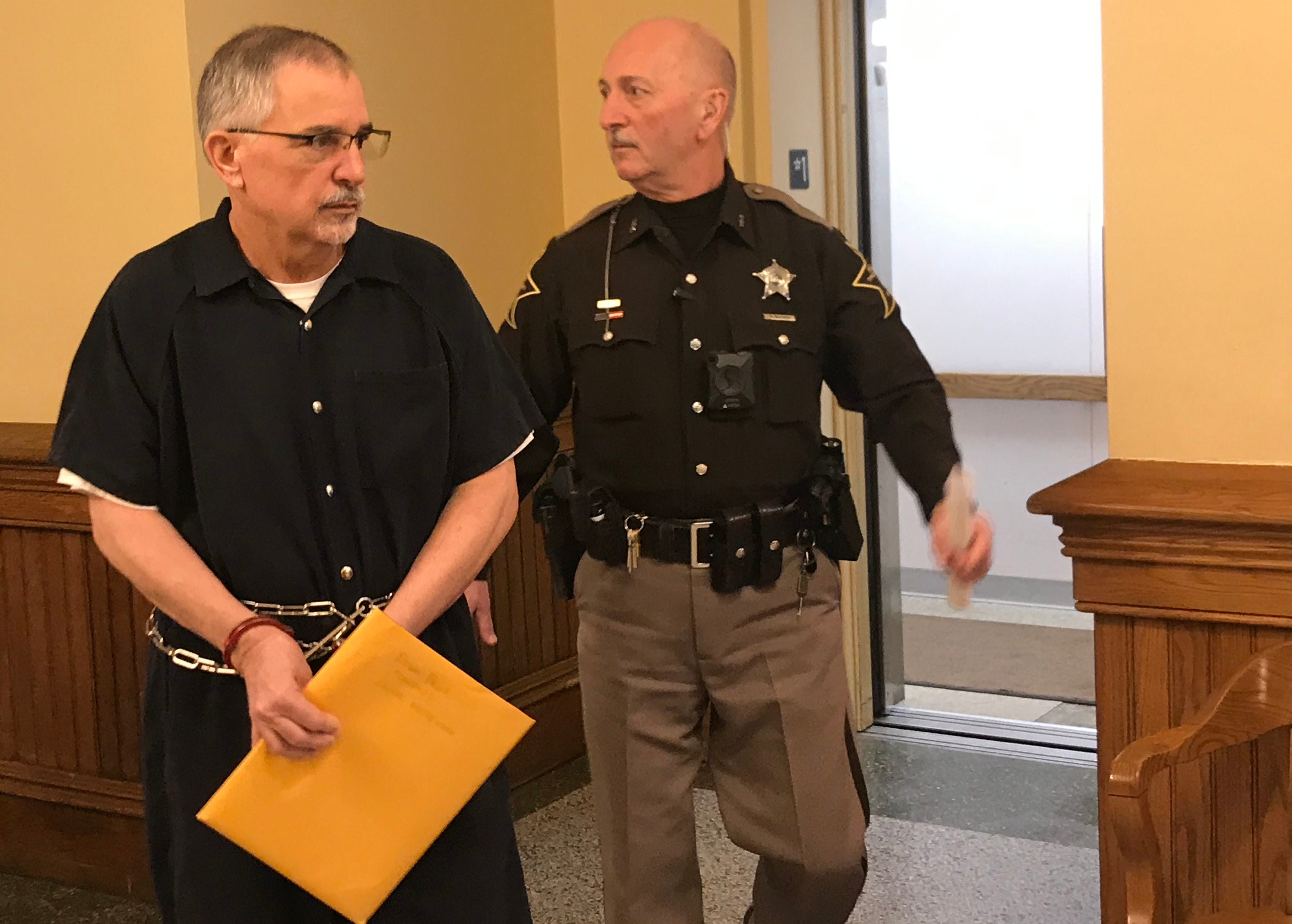 Sixty-two-year-old Douglas Richard Felix leaves the Tippecanoe County Courthouse Thursday afternoon to begin serving a 30-year prison sentence for molesting a child.