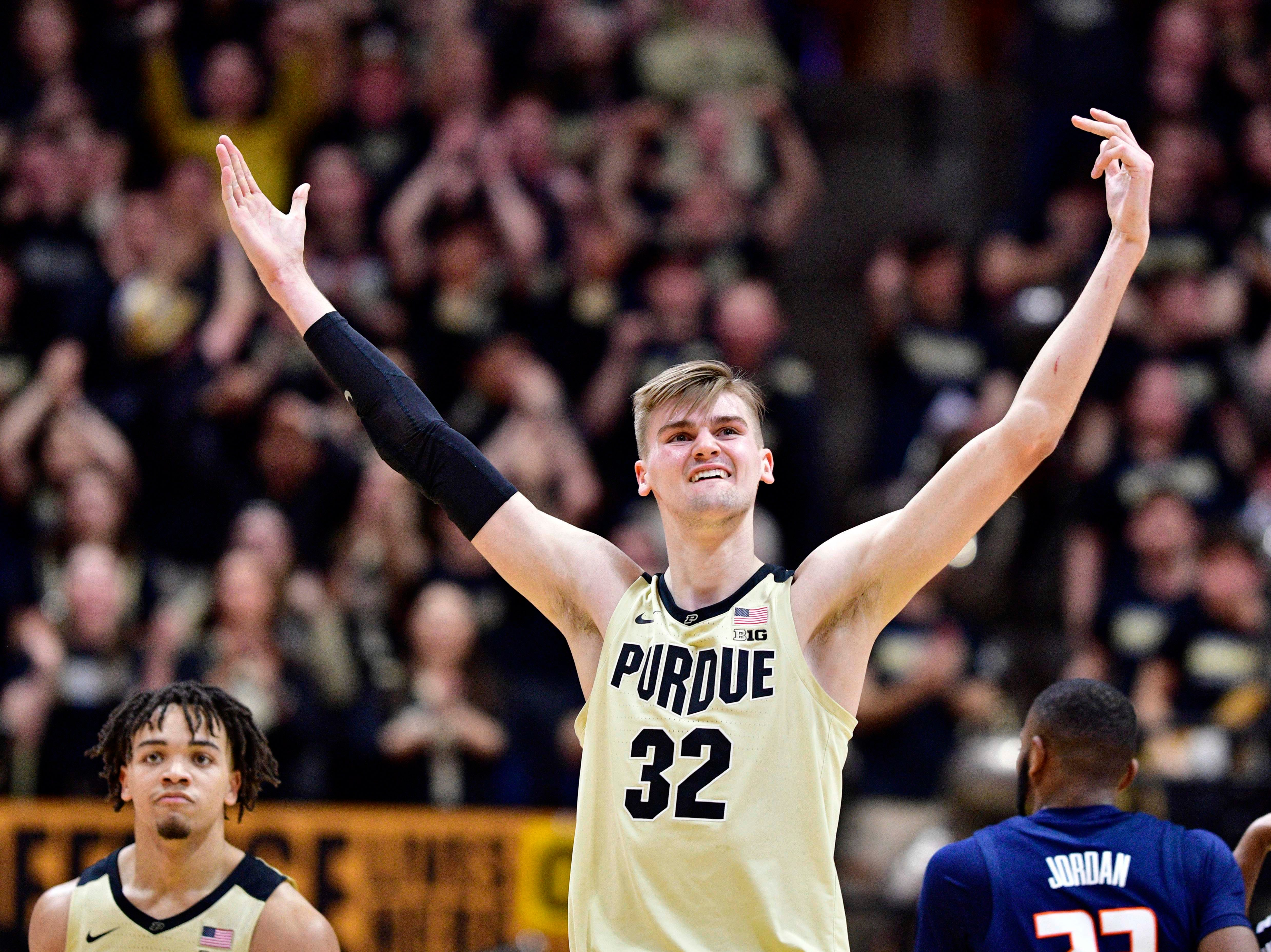 Feb 27, 2019; West Lafayette, IN, USA;Purdue Boilermakers center Matt Haarms (32) motions to the student section after a score during the second half of the game at Mackey Arena. The Purdue Boilermakers defeated the Illinois Fighting Illini 73 to 56. Mandatory Credit: Marc Lebryk-USA TODAY Sports