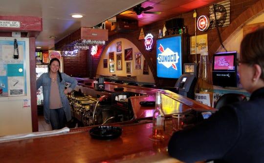 Bartender Jenifer Garrett serves a regular customer at The Station on Greenbush on Thursday, February 28, 2019.