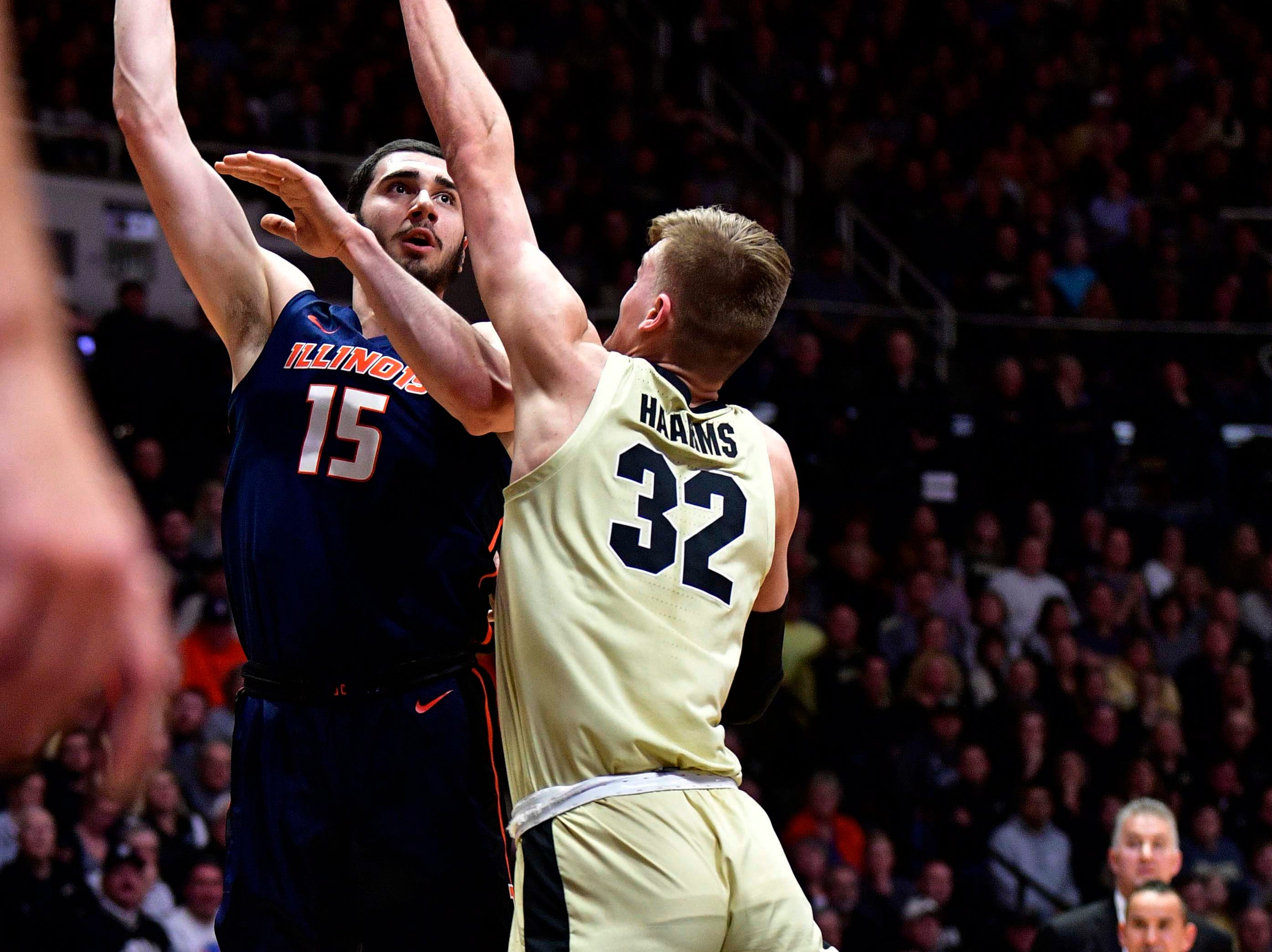 Feb 27, 2019; West Lafayette, IN, USA; Illinois Fighting Illini forward Giorgi Bezhanishvili (15) shoots a shot over Purdue Boilermakers center Matt Haarms (32) during the first half of the game at Mackey Arena. Mandatory Credit: Marc Lebryk-USA TODAY Sports