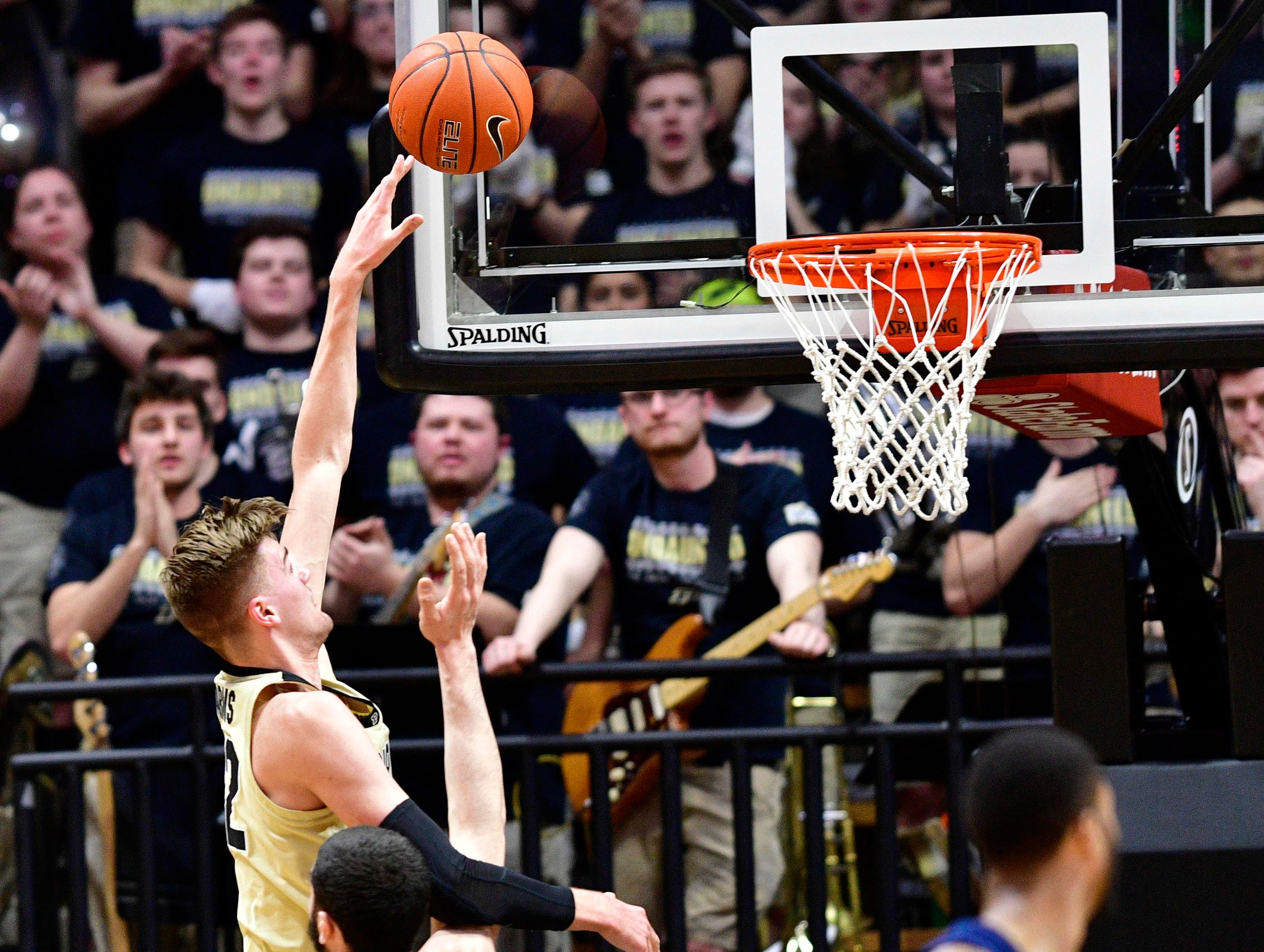 Feb 27, 2019; West Lafayette, IN, USA; Purdue Boilermakers center Matt Haarms (32) shoots the ball over Illinois Fighting Illini forward Giorgi Bezhanishvili (15) during the first half of the game at Mackey Arena. Mandatory Credit: Marc Lebryk-USA TODAY Sports