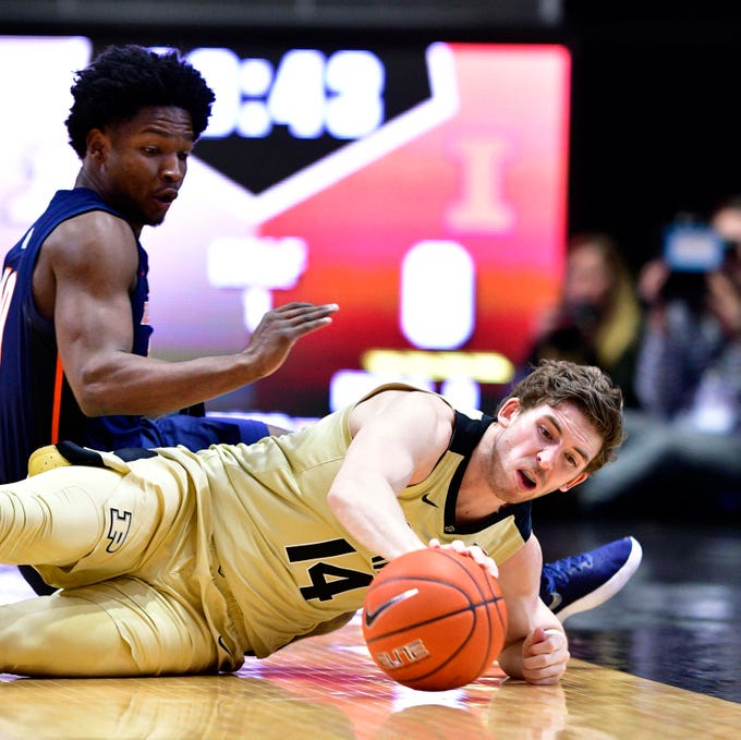 Feb 27, 2019; West Lafayette, IN, USA; Purdue Boilermakers guard Ryan Cline (14) goes after a downed ball against Illinois Fighting Illini guard Andres Feliz (10) during the first half of the game at Mackey Arena. Mandatory Credit: Marc Lebryk-USA TODAY Sports