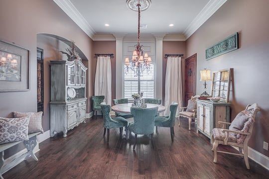 The formal dining room includes designer touches and colors.