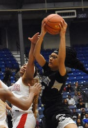 Northwest's Katlyn Manuel (25, right) comes up with a rebound against Loranger's Jamya Mingo-Young (4, left) in the LHSAA Class 3A semifinals held Wednesday, Feb. 27, 2019 at the Rapides Parish Coliseum in Alexandria.