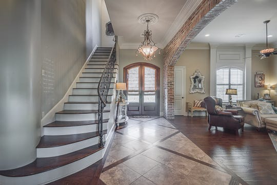 A beautiful staircase greets you at the entry.