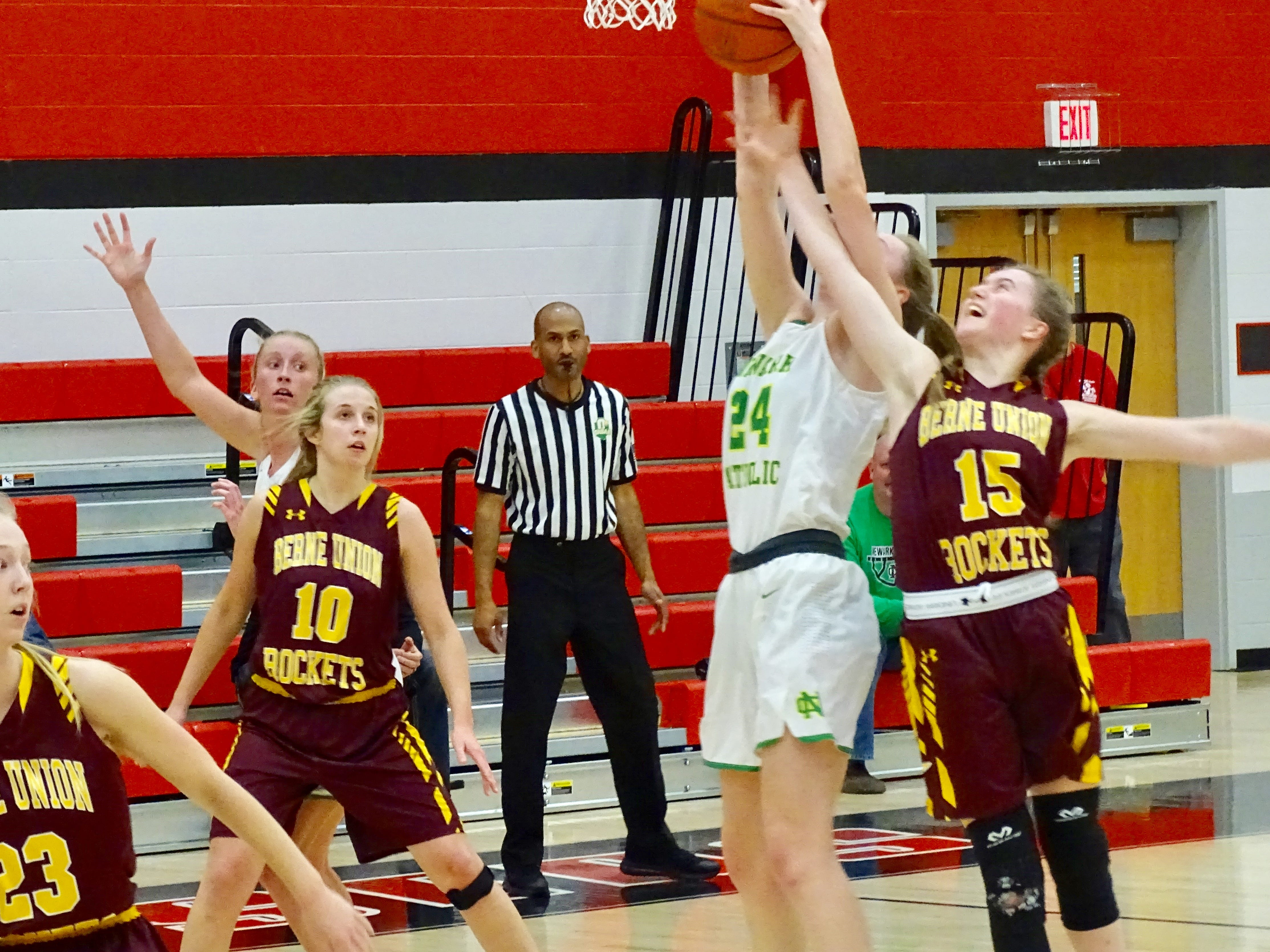 Berne Union's Emily Blevins fights for a rebound against Newark Catholic's Shannon Keck during a Division IV district semifinal final Wednesday at Groveport High School. The Green Wave won 59-30.