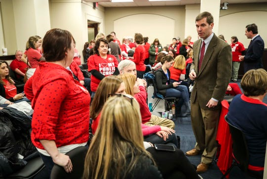 Andy Beshear, Kentucky's attorney general, and Adam Edelen, far right in dark suit, greeted teachers as they waited to hear the introduction of House Bill 525 in Frankfort Thursday, Feb. 28, 2019. Both are candidates for governor of Kentucky.