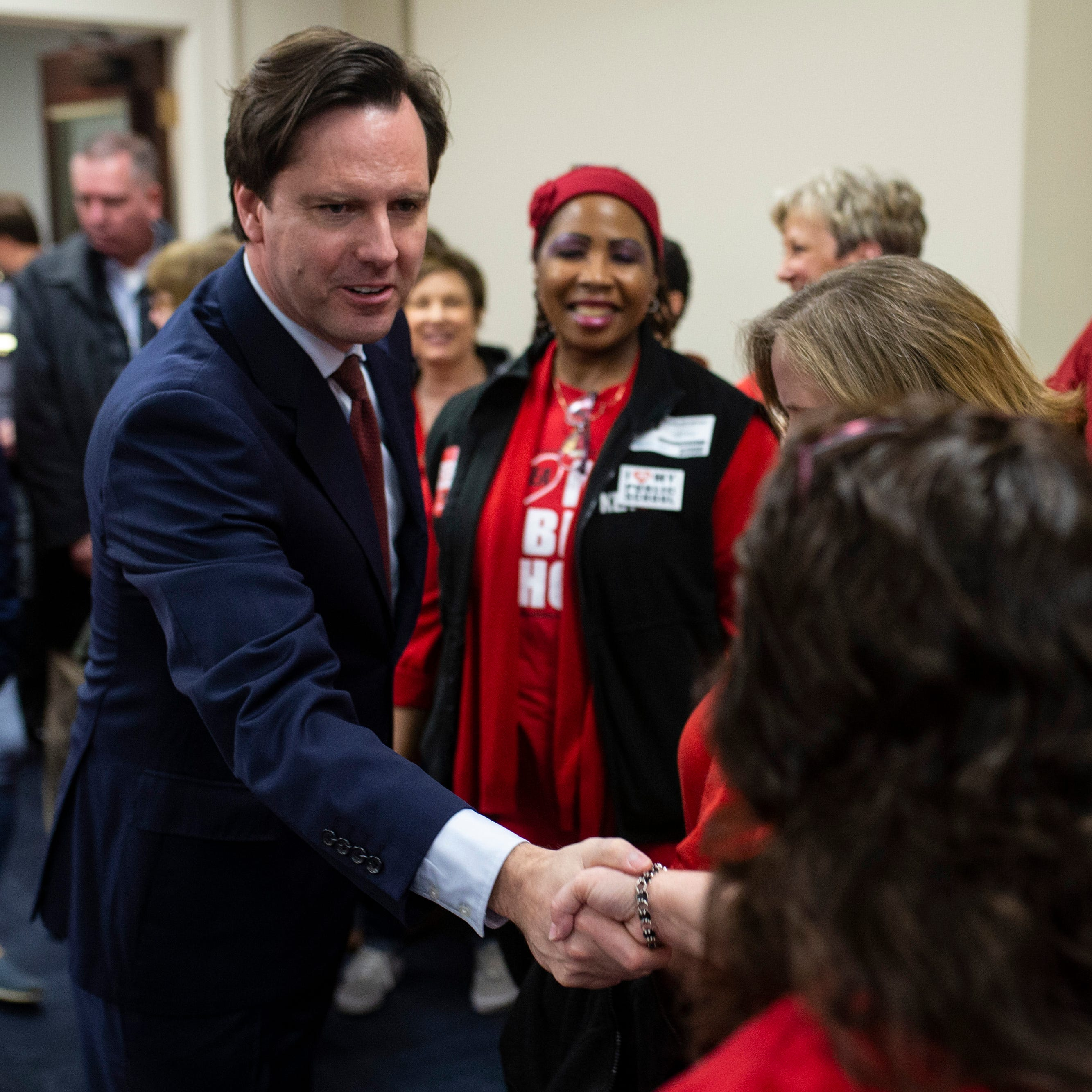 Governor candidate Adam Edelen shakes hands with Kentucky teachers before the hearing for House Bill 525 at the Kentucky Capitol on Thursday. Feb. 28, 2019