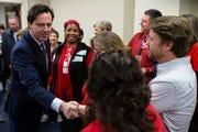 Adam Edelen shakes hands with teachers during a Kentucky teacher sickout protest in Frankfort on Feb. 28.