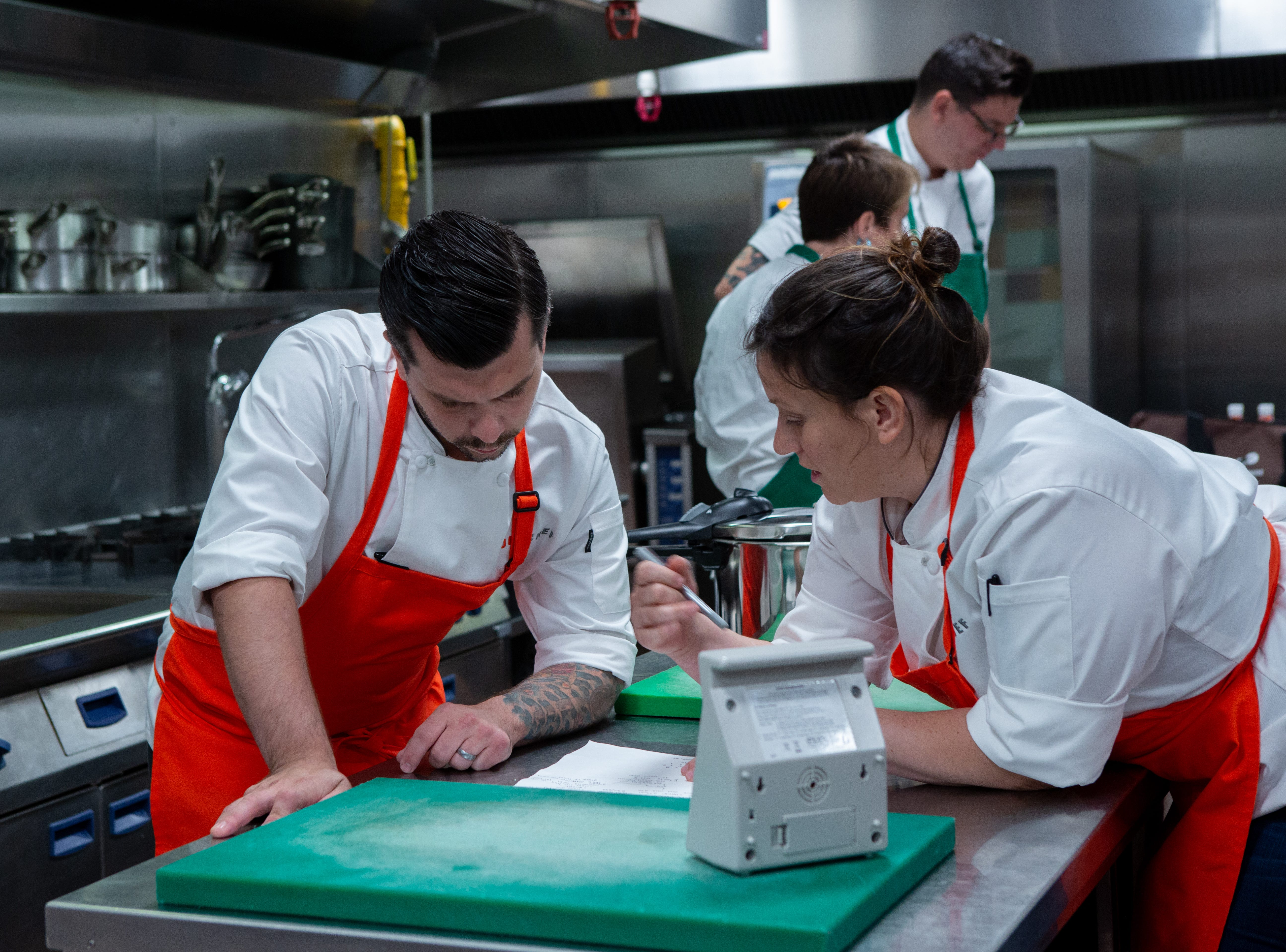 "Former contestant Eddie Konrad works with Sara Bradley on ""Holy Macau!"" episode 13 of Bravo's 'Top Chef:' Kentucky season."