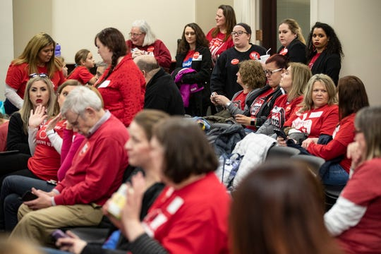 Kentucky teachers wait for the hearing on house bill 525 at the Kentucky Capitol on Thursday. Feb. 28, 2019