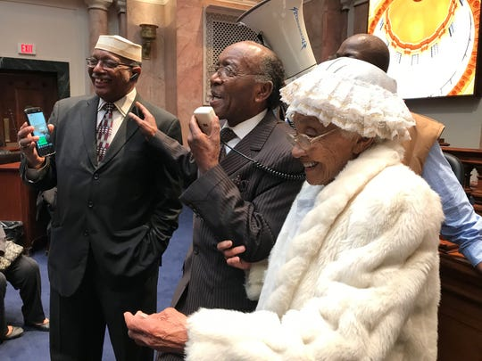 Rev. Charles Elliott, center, introduced Lucille B. Leggett, age 100, at a prayer rally Thursday in support of Passport Health Plan and its planned headquarters in West Louisville.