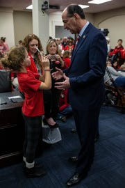 Kennedy Crovo, 12, left, interviews Kentucky Governor candidate Rocky Adkins as Kentucky teachers awaited the start of the hearing for House Bill 525 at the Kentucky Capitol on Thursday. Kennedy's mother, Sharessa Crovo, is a school teacher in Lexington. Feb. 28, 2019