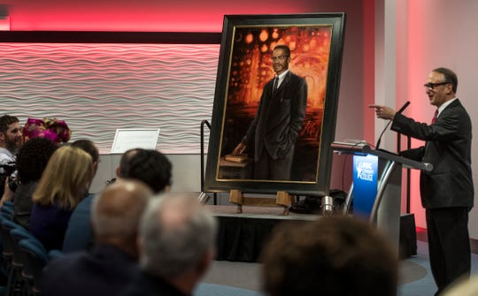 Lansing Community College President Brent Knight talks about artist Joshua Risner's oil painting of Malcolm X  Thursday, Feb. 28, 2019, after the unveiling of the portrait.  The final day of Black History month kicked off LCC's year-long participation in the 400 Years of African American History Commission.