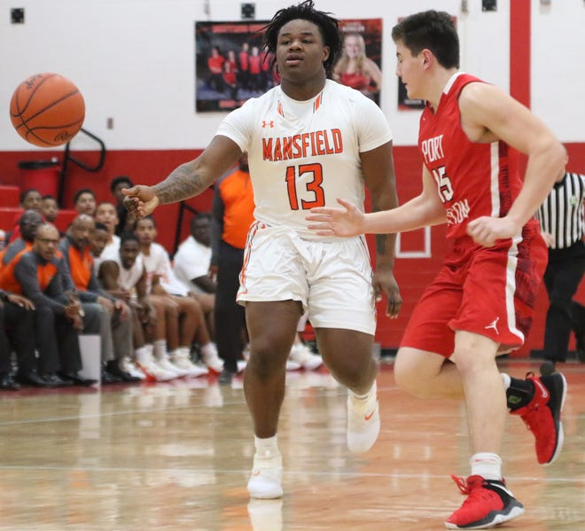 Mansfield Senior's Quan Hilory makes a no-look pass during the Tygers' sectional semifinal win over Port Clinton last week.