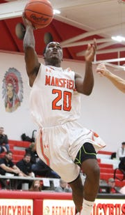 Mansfield Senior's Tavion Harris shoots a layup during the Tygers' victory over Port Clinton in the Division II sectional semifinal on Wednesday night at Bucyrus High School.