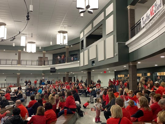 Madison teachers and supporters pack a school board meeting held Wednesday. Teachers are entering the second month of a soft strike to protest unresolved contract negotiations.