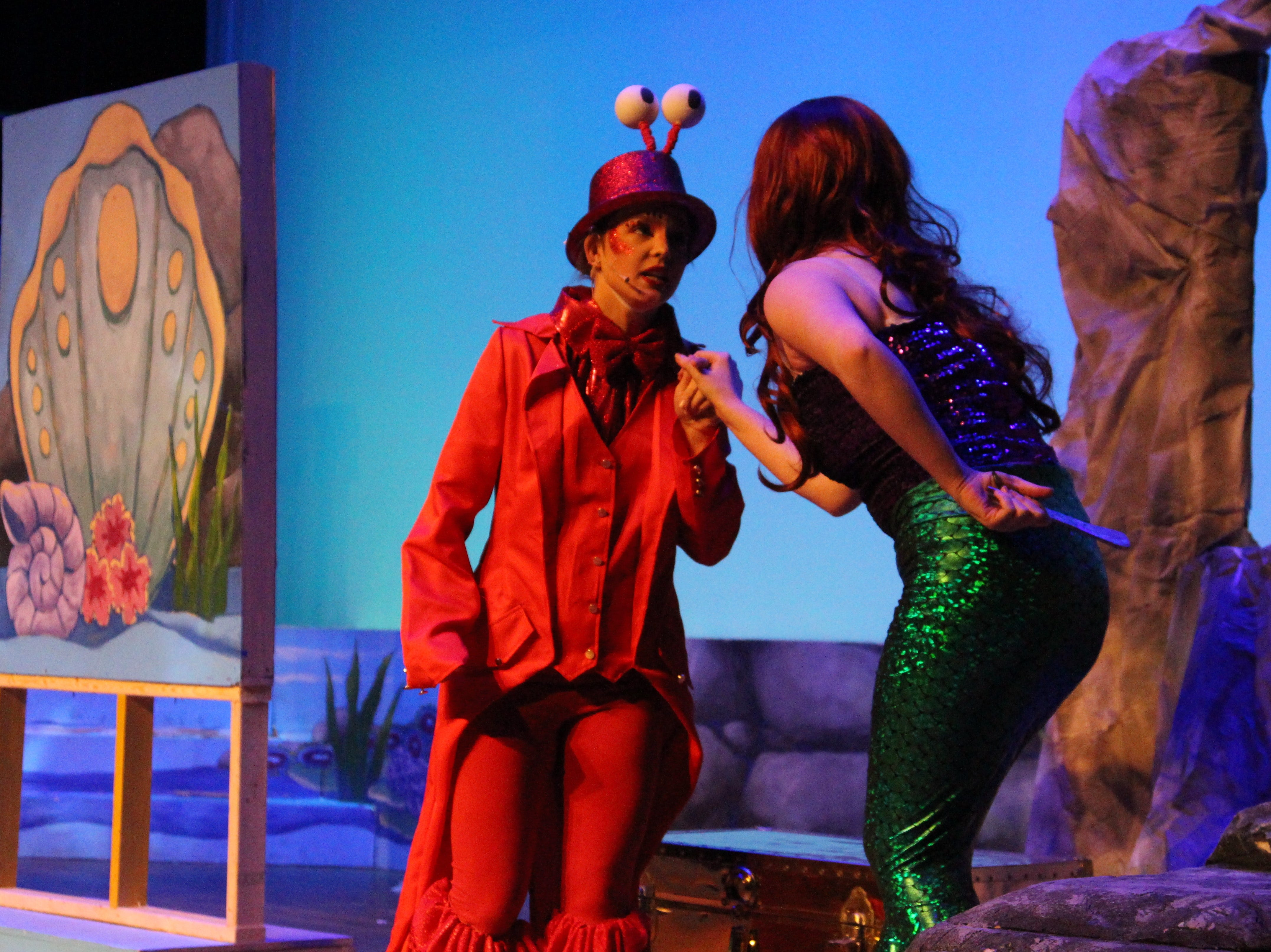 "Senior Kamryn Dyer plays the crustacean Sebastian, servant to King Triton and friend of Princess Ariel, during Ridgedale's production of Disney's ""The Little Mermaid."" The show will be held at the Marion Palace Theatre over the weekend. Showtimes are at 7:30 p.m. on Friday and Saturday, March 1 and 2, and at 2 p.m. on Sunday, March 3."