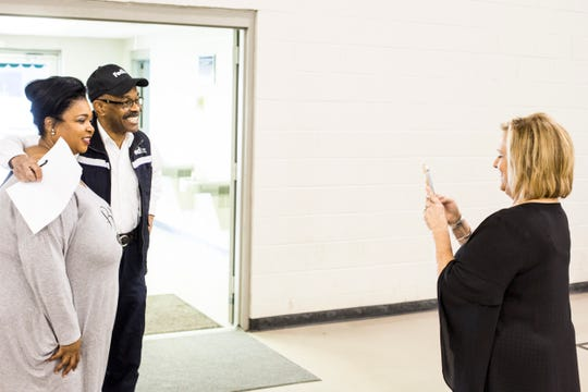 February 28, 2019 - Christi Webb, right, takes a picture of Pam Chatman, left, with FedEx employee Gerald Morris during a hiring blitz event held by FedEx in Cleveland, Mississippi. Five nights a week, FedEx Express buses nearly 200 employees from Cleveland, Mississippi to its Memphis World Hub Ñ a four-hour round trip each work day.