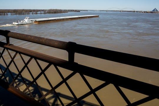 A towboat pushes upriver on the swollen waters of the Mississippi River on Feb. 24.