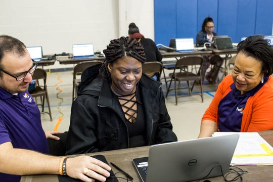 February 28, 2019 - Shemika Nelson, center, works with Mason Castellaw, left, and Dyeann Bryant, right, while filling out paperwork during a hiring blitz event held by FedEx in Cleveland, Mississippi. Five nights a week, FedEx Express buses nearly 200 employees from Cleveland, Mississippi to its Memphis World Hub Ñ a four-hour round trip each work day.