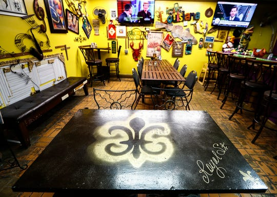 A  fleur de lis adorns a table inside Mardi Gras Memphis restaurant on North Watkins Ave.