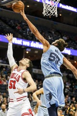 February 27, 2019 - Joakim Noah, right, gets a block against Chicago's Ryan Arcidiacono during Wednesday night's game versus the Chicago Bulls at the FedExForum.