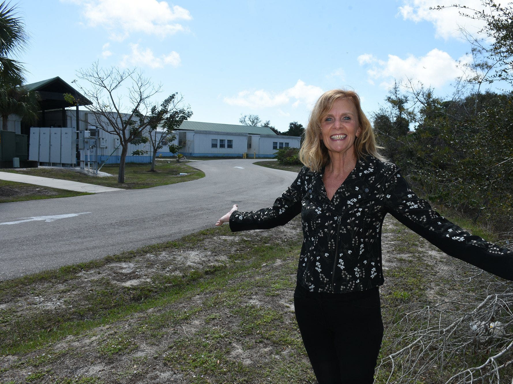 Principal Melissa Scott shows where the school's new buildings will rise. Marco Island Academy is embarking on a capital campaign to raise millions of dollars and give the school a permanent home, after years of operating in prefab modules.