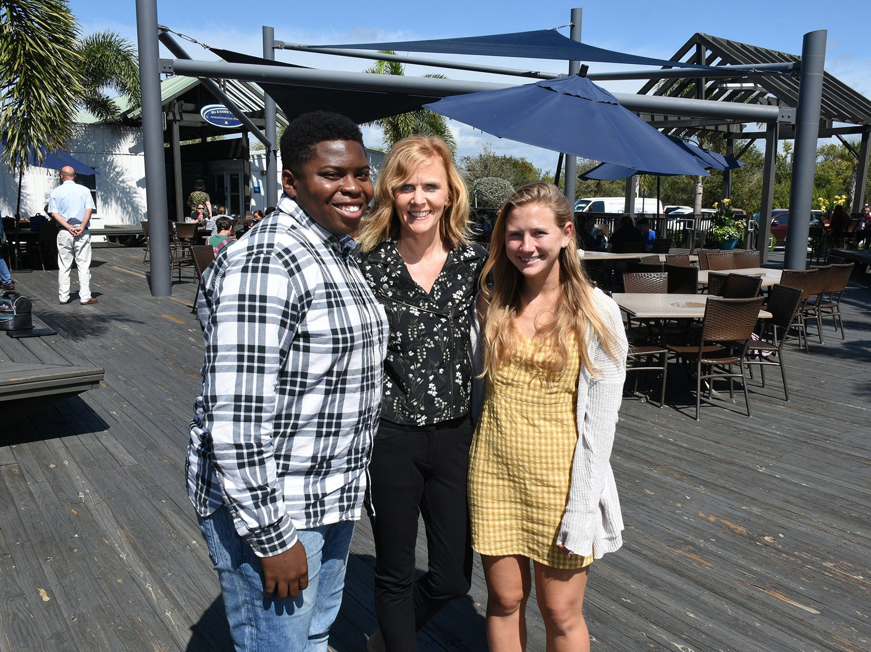 Principal Melissa Scott with students Teagan Havemeier and Evans Metelus, left. Marco Island Academy is embarking on a capital campaign to raise millions of dollars and give the school a permanent home, after years of operating in prefab modules.