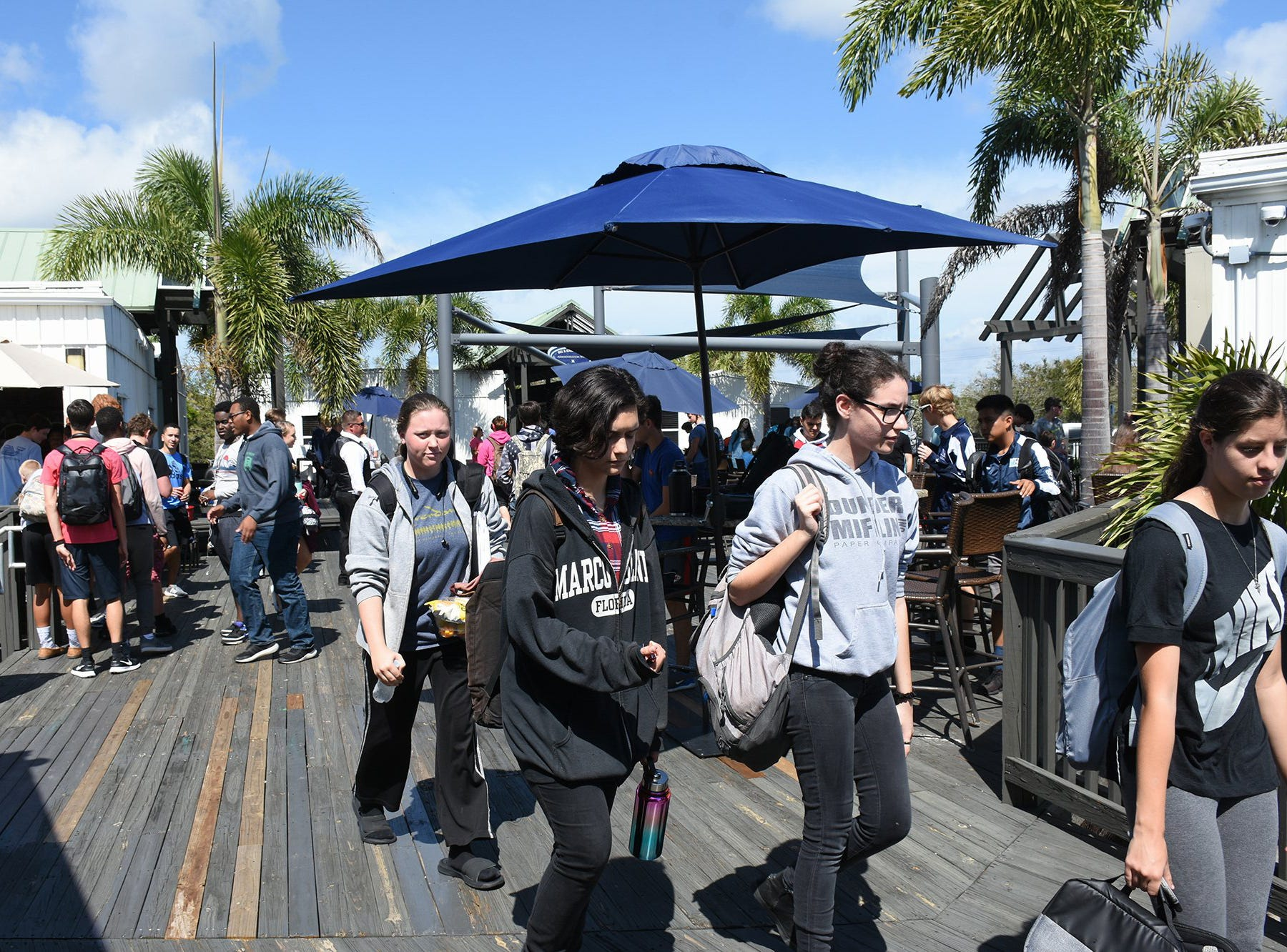 Students head to classes on the rickety wooden deck. Marco Island Academy is embarking on a capital campaign to raise millions of dollars and give the school a permanent home, after years of operating in prefab modules.