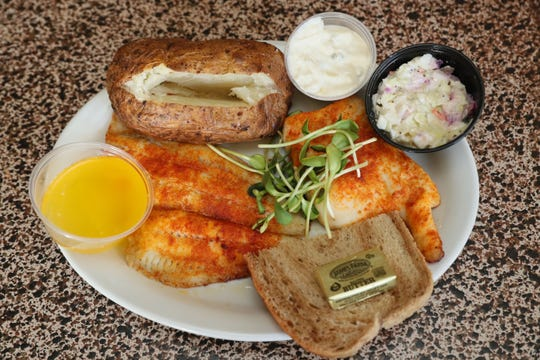 A number of the 21 kinds of fish at the Thistle & Shamrock in Milwaukee can be ordered baked, such as this grouper (left) and arapaima (right), a fish native to the Amazon with a taste and texture similar to chicken.
