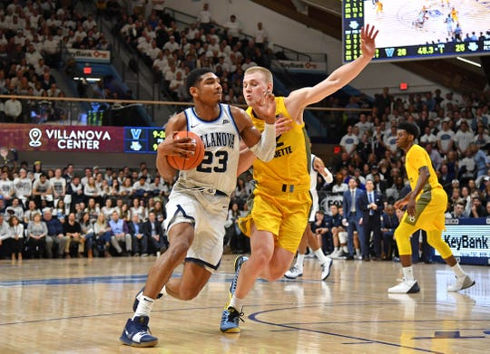 Villanova's Jermaine Samuels drives against Marquette's Joey Hauser.