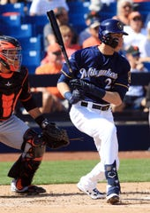 Christian Yelich hits into a fielder's choice during the first inning Thursday in his first appearance of spring.