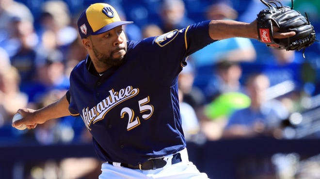 Brewers reliever Jay Jackson, who's trying to make the team as a non-roster invitee, delivers a 1-2-3 inning against the Indians on Wednesday.