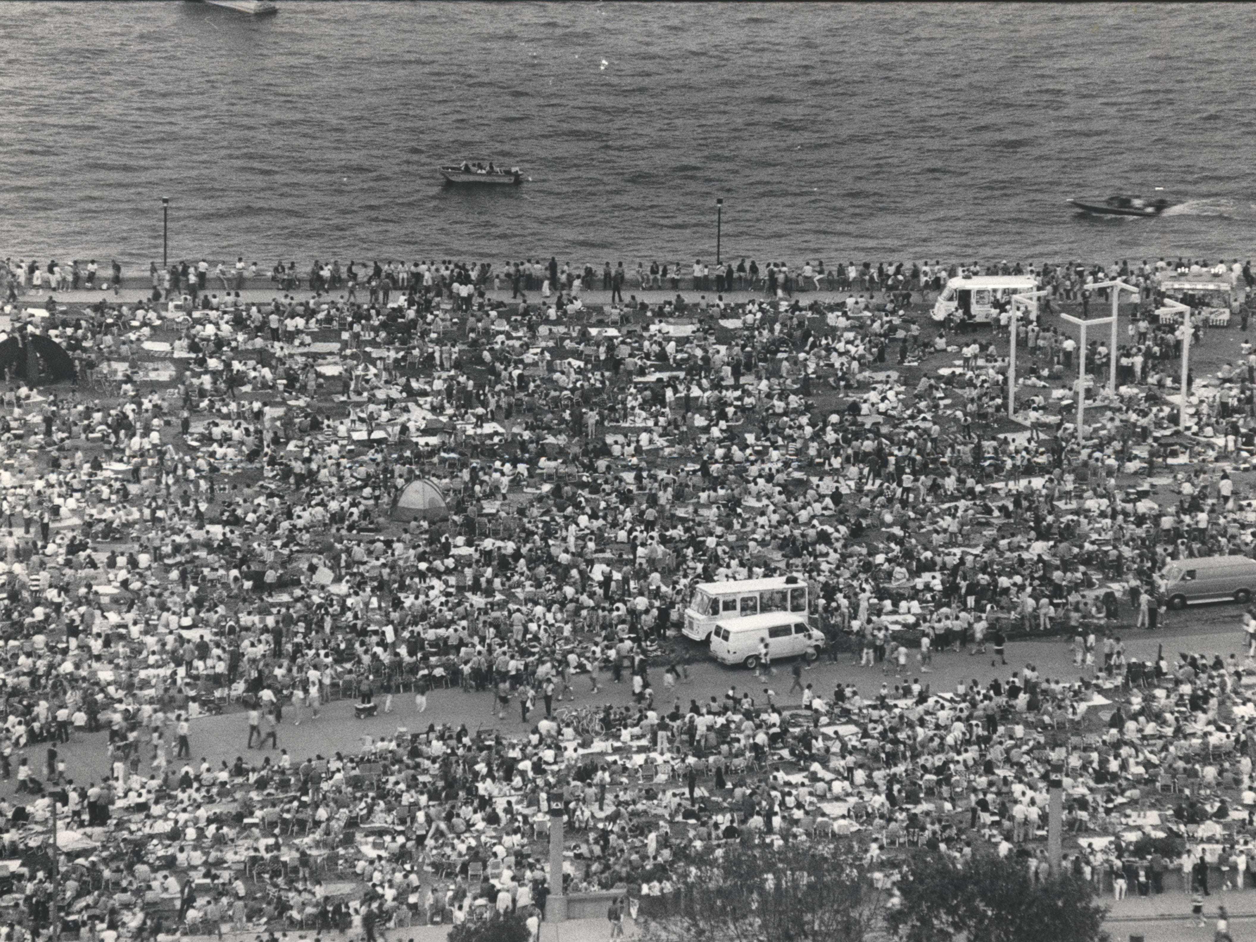 Tens of thousands of spectators fill Juneau Park, north of the War Memorial Center, before the First Wisconsin Fireworks on July 3, 1987. Police officers patrolling the area said the crowd was in a festive mood and extremely well-behaved.