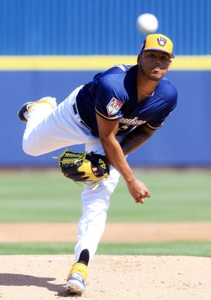 The Brewers' Freddy Peralta pitches against the Giants on Thursday, in Phoenix, Arizona.