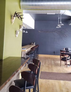 The decor at Wild Roots, which is to open soon at 6807 W. Becher St. in West Allis, suggests its connection to nature and the seasons, such as the deer antlers on one wall and an apple tree branch on another.