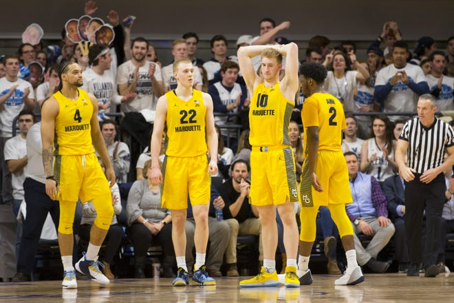 Theo John (from left), Joey Hauser, Sam Hauser, Sacar Anim and the rest of the Golden Eagles saw a chance to clinch the No. 1 seed in the Big East go by the wayside against Villanova on Wednesday night.