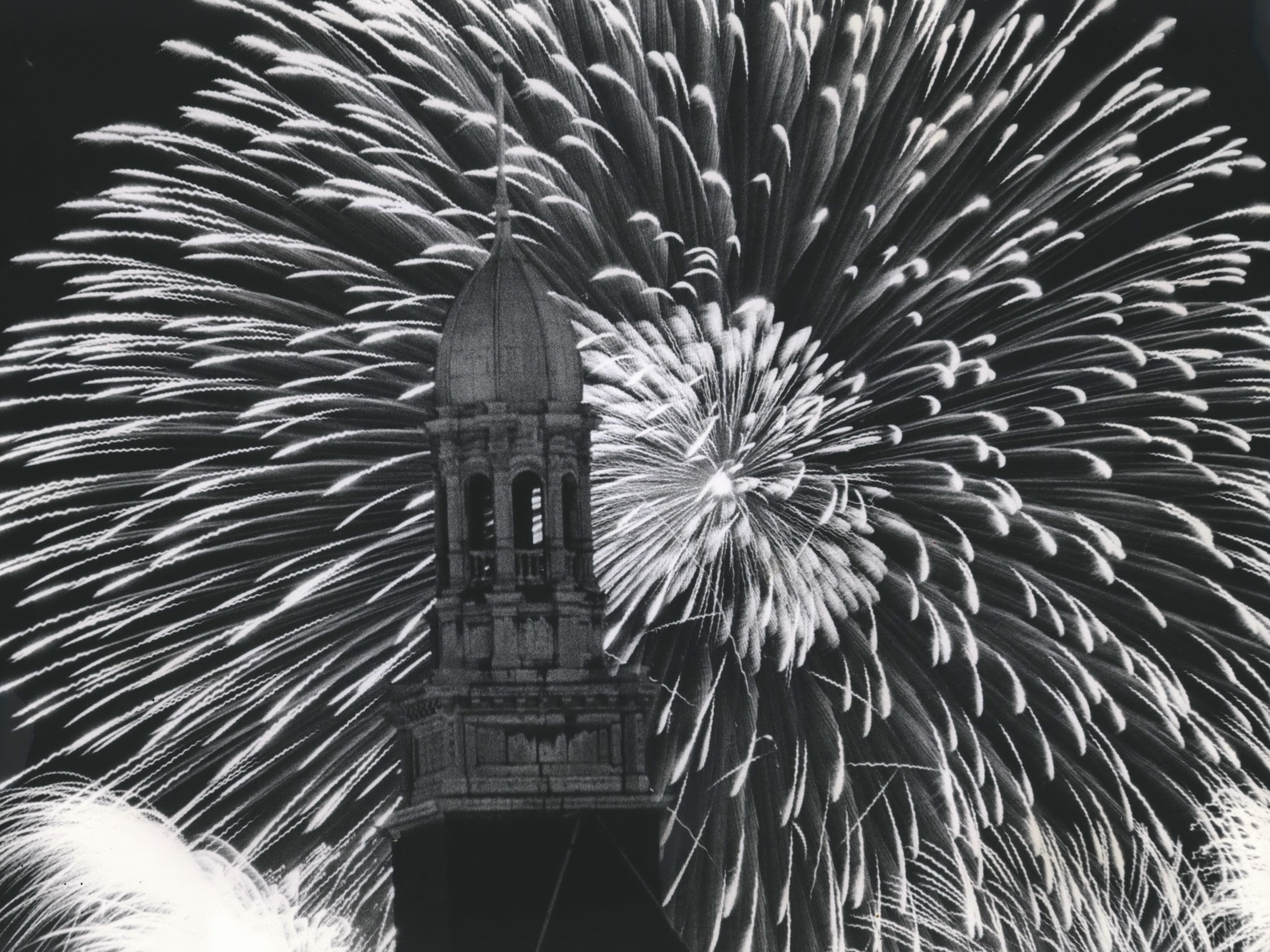 Sprays of light burst in the sky behind City Hall tower in a Fourth of July salute. on July 4, 1965. Thousands crowded into lakefront parks to view the fireworks, the third year they were sponsored by Jos. Schlitz Brewing Co. this photo was published in the July 6, 1965, Milwaukee Journal.