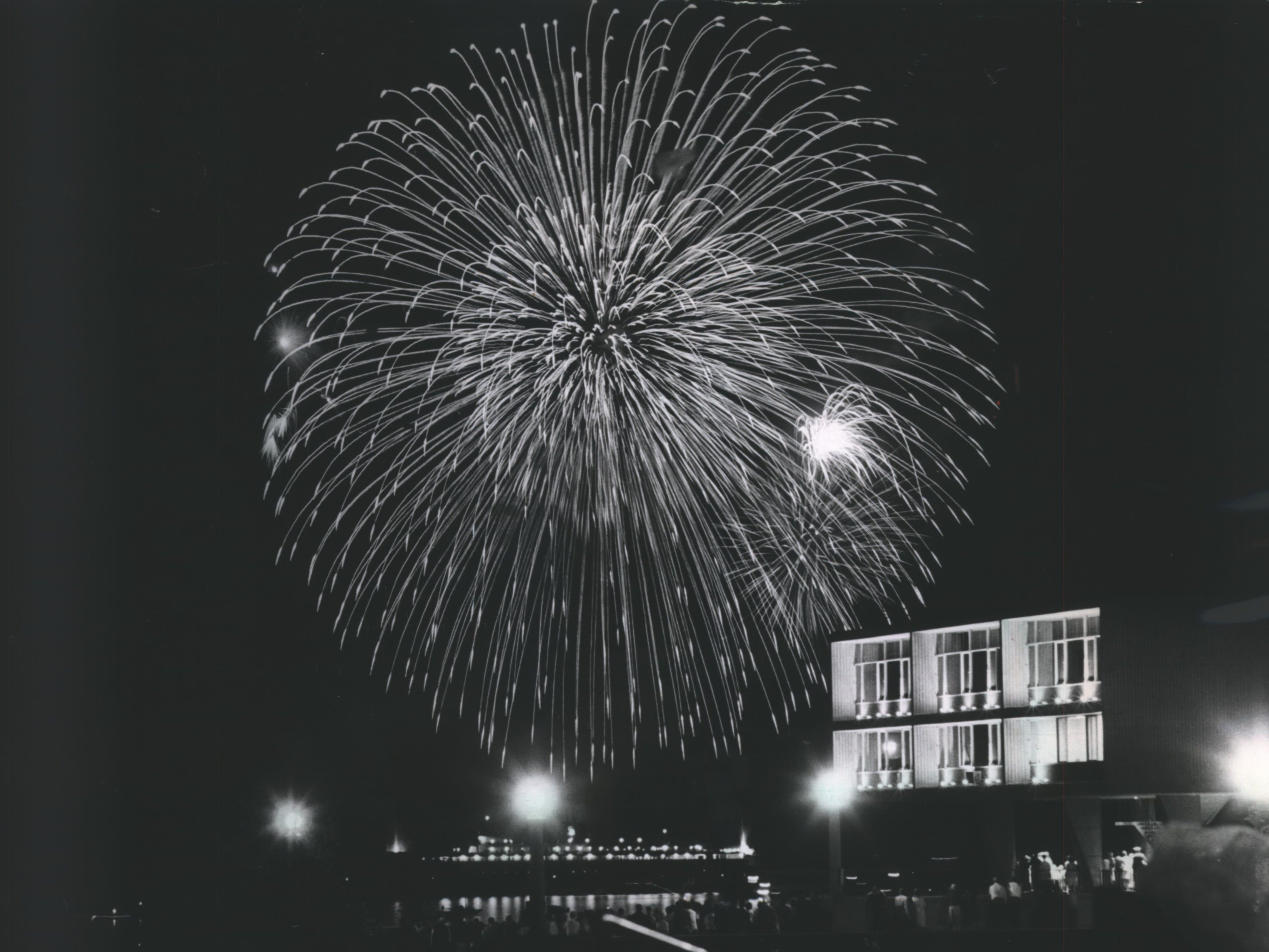"""The big """"Day in Old Milwaukee"""" ended with fireworks at the lakefront on July 4, 1964. It was the second year Jos. Schlitz Brewing Co. sponsored the Great Circus Parade and a big lakefront fireworks show on July 4. The fireworks, shown bursting over the War Memorial Center, were fired off the deck of the carferry SS Badger, seen at the bottom of the photo. This picture was published in the July 6, 1964, Milwaukee Sentinel."""