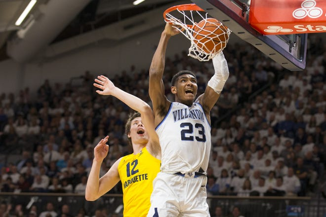 Villanova's Jermaine Samuels dunks the ball over Marquette's Matt Heldt on Wednesday night.