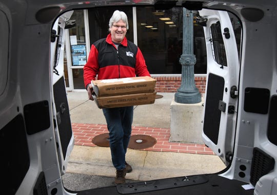 Mike Pettey of MailCo USA carries out mail trays filled with 2018 property tax statements Thursday morning at the Baxter County Collector's Office. The county will mail out 26,000 printed statements and email another 5,000 statements, Collector Teresa Smith said.