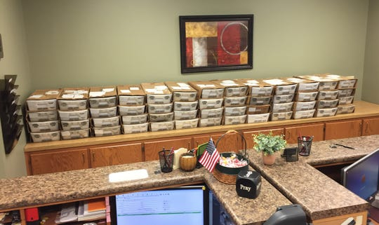 More than 26,000 tax statements sit on a counter in the Baxter County Collector's Office on Thursday morning. The statements should arrive in taxpayers' mailboxes by early next week.