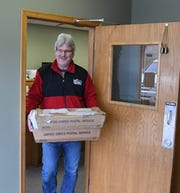 Mike Pettey of MailCo USA carries out mail trays filled with 2018 property tax statements Thursday morning at the Baxter County Collector's Office. The statements should arrive in taxpayers' mailboxes by next week at the latest.