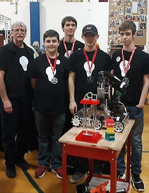 The Mountain Home First Tech Challenge Team 7572 Lights On had a good weekend in Springdale. The local team was part of an alliance with two other teams that won the Arkansas State FIRST Tech Team Challenge. Members of the team are: (from left) mentor John Novak, George Smith, Chase Blum, Nick Huett and Gage Simmons.
