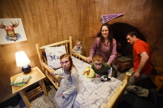 "Amy Marini and her husband Cliff play inside of Bear Cave together with their children Lara (age 8), Lucas (age 10), who suffer from Cockayne Syndrome, the genetic ""rapid-aging"" disease, and Leyton (age 2, L of mother), after the NBC TV show ""George to the Rescue"" which does expert home makeovers and renovations for families-organizations with special needs, renovated their basement, photographed at the Marini family home in Long Valley on 02/28/19."